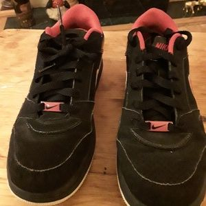 Youth black and red Nike tennis shoes